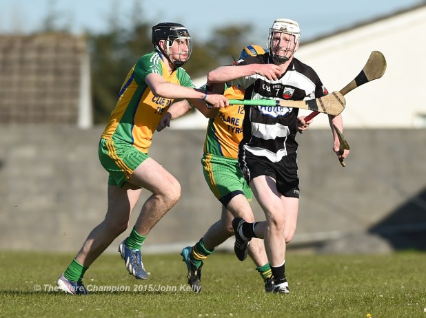 David Fitzgerald of Inagh-Kilnamona in action against Conor Galvin of Clarecastle during their Clare Champion Cup game in Inagh. Photograph by John Kelly.