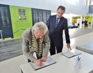 James Breen, Cathaoirleach of Clare County Council, and Gerard Dollard, director of services, sign the Books of Condolences at Áras Contae an Chláir