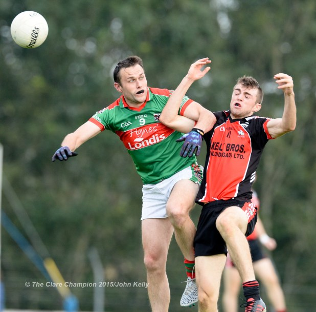 Peter O Dwyer of Kilmurry Ibrickane in action against Cillian Brennan of Clondegad during their Cusack Cup final in Kilmihil
