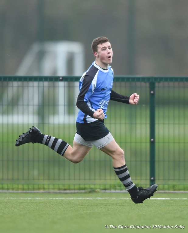 Tiernan Agnew of St Caimins celebrates his try against Abbey CBS.