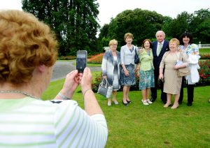 MC Marty Whelan poses for pictures with fans during the garden party. Photograph by John Kelly.