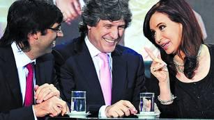 Sonrisas. Cristina Kirchner junto a Amado Boudou y Diego Bossio, en noviembre de 2012, en la Casa Rosada./TELAM