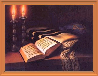 Bible on a table with candles in background