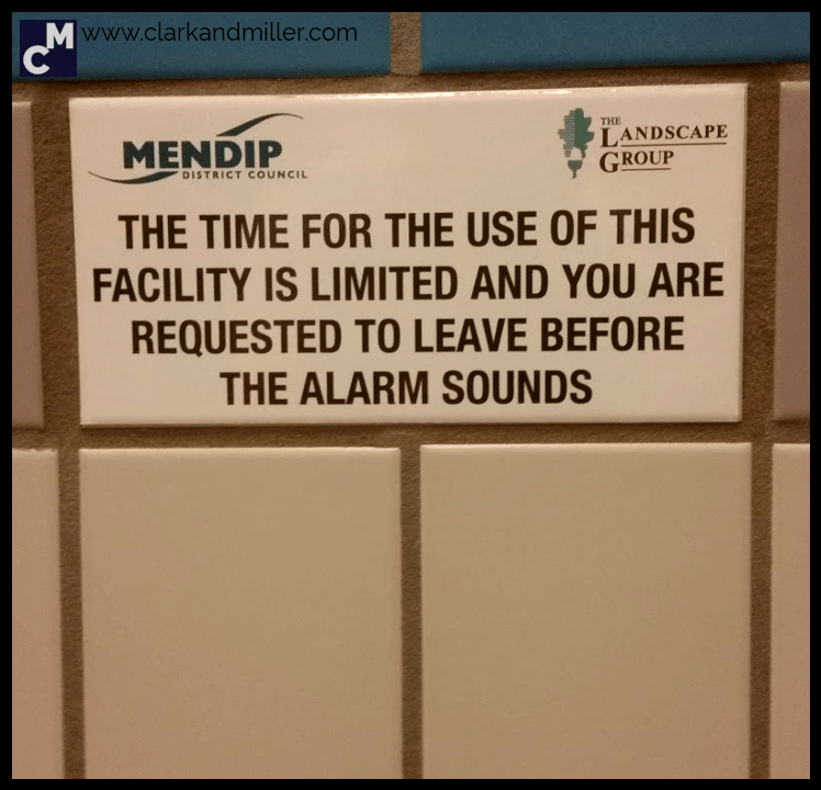 Sign in a UK public toilet: The time for the use of this facility is limited and you are requested to leave before the alarm sounds