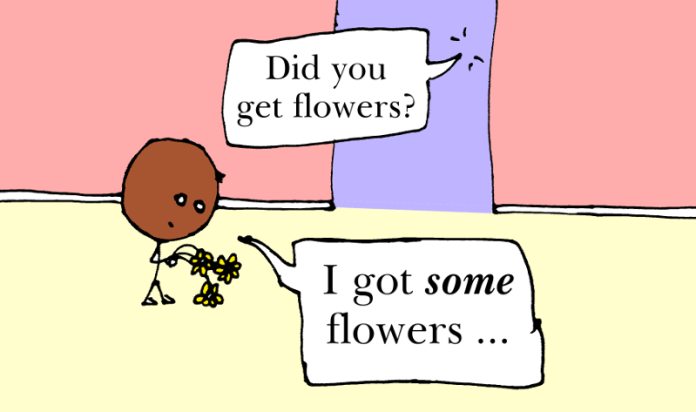 A man holding a very small bunch of flowers. Did you get flowers? I got some flowers.