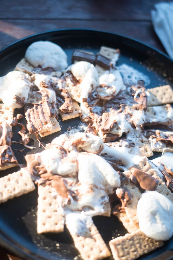 A pan of food on a plate, with Traeger and Smoking