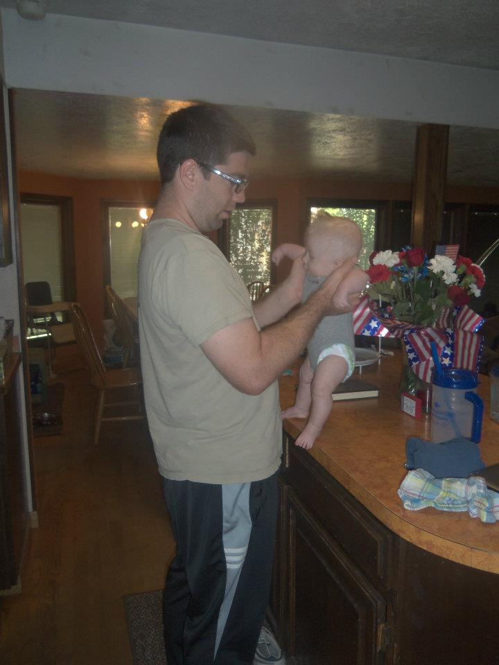 A man holding his baby