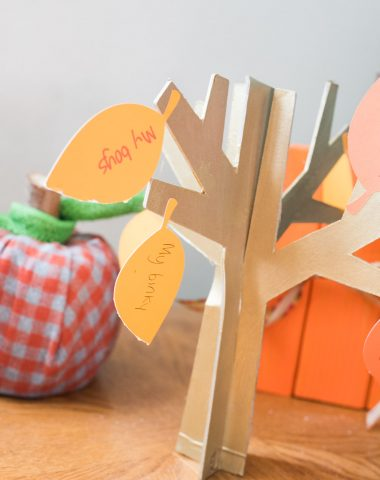 A wooden decorative tree on a table