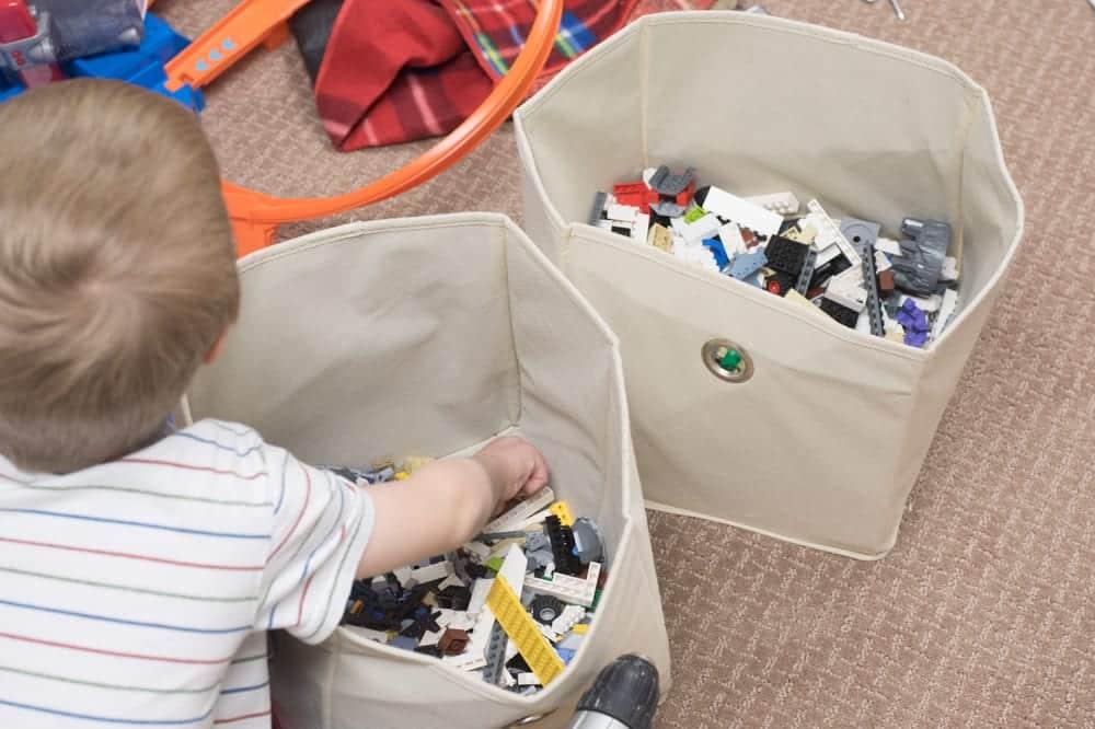 child digging through lego bin