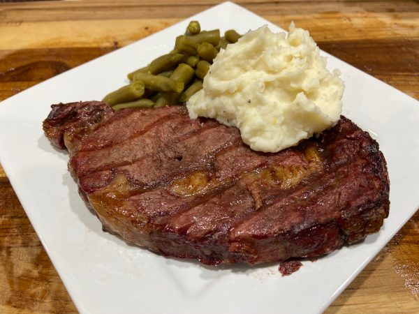 A piece of food on a plate, with Rastelli\'s and Steak