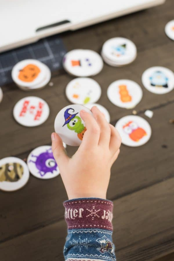 child holding a matching game piece