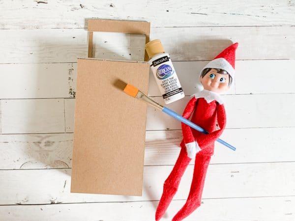 Elf near a cardboard box