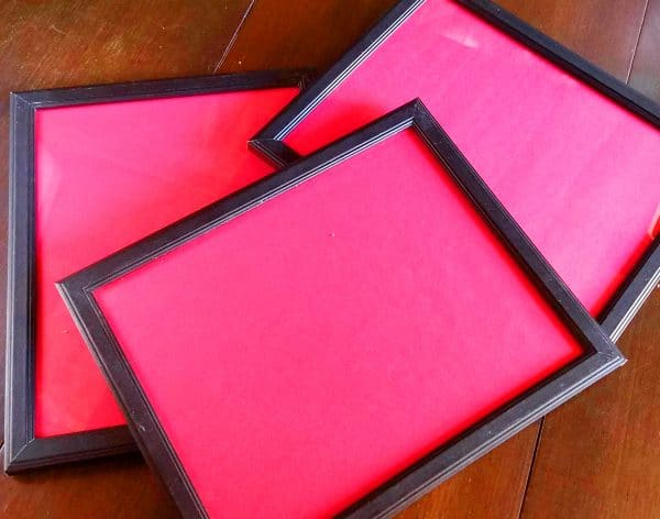 A close up of pink photo frames