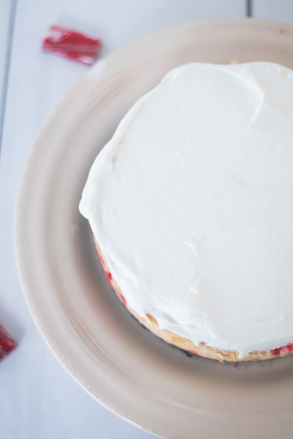 A piece of cake on a plate, with icing
