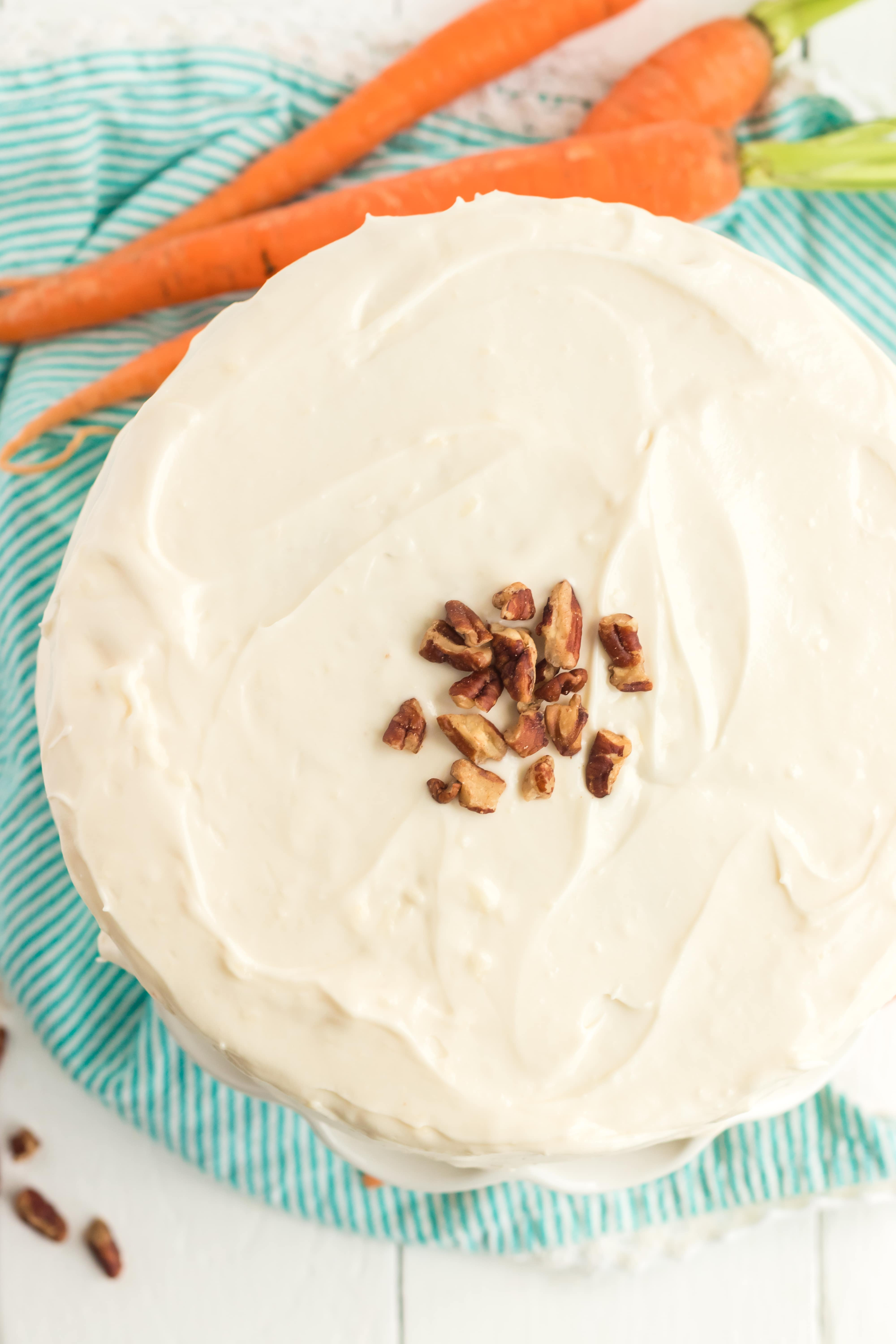 Carrot cake with icing and decorations on it