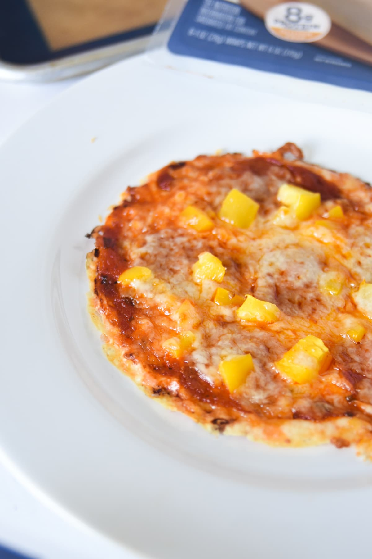 Easy low carb pizza that is crustless. Plated on a white plate.