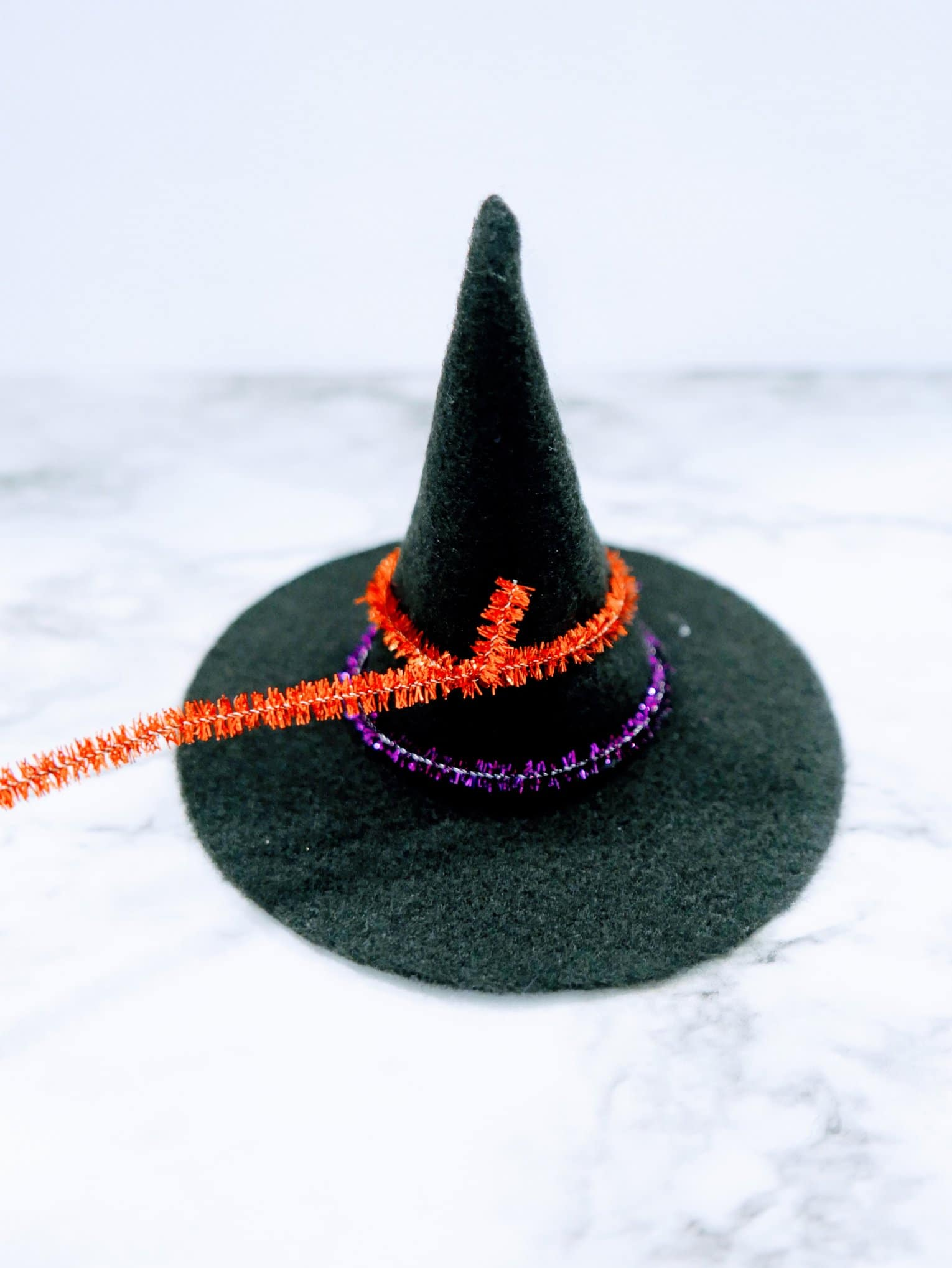 felt witches hat with pipe cleaners