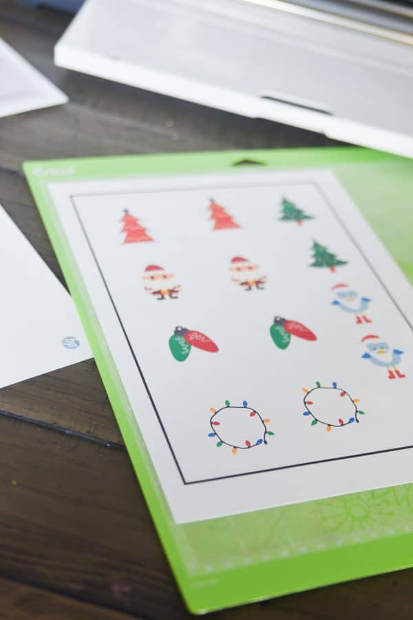 cricut christmas stickers on green mat