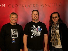 Clark Kirkwood with Alex Lifeson and Geddy Lee of RUSH