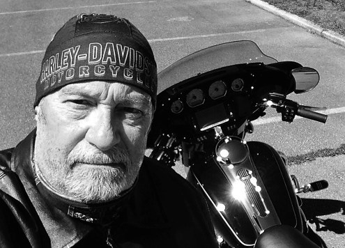 Hank Bonecutter with his Harley Davidson