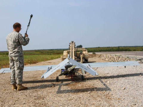 "Spc. Thomas Olsen, a Tactical Unmanned Aerial System maintainer assigned to the TUAS Platoon, Company B, 3rd Special Troops Battalion, 3rd Brigade Combat Team ""Rakkasans,"" 101st Airborne Division (Air Assault), calls in another systems check before loading the Shadow Unmanned Aerial System on the launcher at Fort Campbell, Ky., Sept. 9, 2013. Olsen and the rest of his platoon spent three weeks in the field to advance their skills and to increase their readiness level so they are ready to assist the brigade on future missions. (Spc. Brian Smith-Dutton/U.S.Army)"