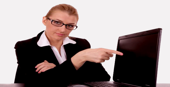 Business woman to point on laptop
