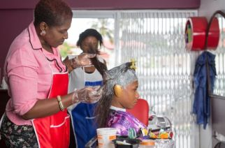 St Claire Adotey specialises in hairstyles like perms - but they have fallen out of fashion