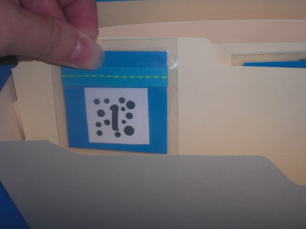 Each number attaches to a manila folder.