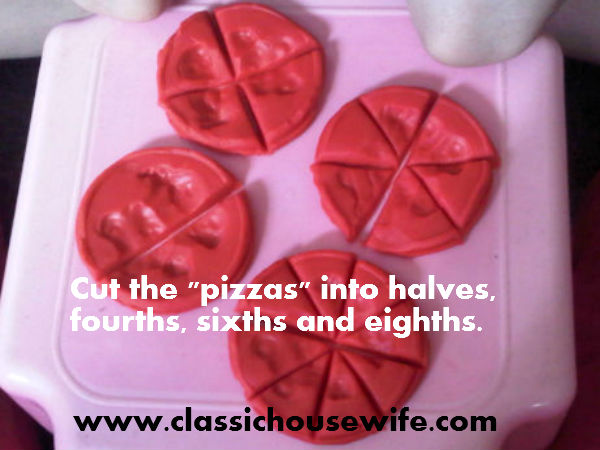 cutting the playdough pizzas with different numbers of slices