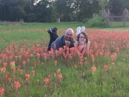Arielle posing in the flowers with her dad -- the kids have a great relationship with him, too!