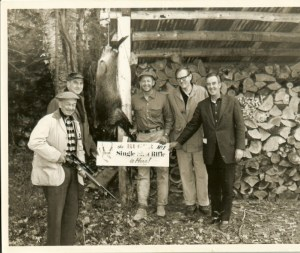 Bill Ruger and Group at Corbin Park with the new Ruger No.1. (R-L) Ed Nolan, Sales Manager; Bill Ruger; Robert E. Peterson, Peterson Publishing; Kneeland Wheeler, Caretaker at Corbin Park. Gentleman holding the new Ruger No.1 is not identified.
