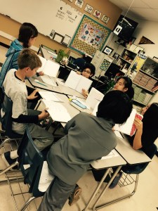 Students working collaboratively to determine the quality of work in their Interactive Science Notebooks.