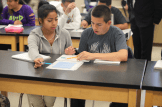 Elbow partners Andrew Harrison and Issayra Villalba review the data table of average temperatures in Galt.