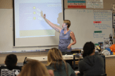 Lisa Hegdahl explains a graphic that is a new resource the students can use to develop their models.