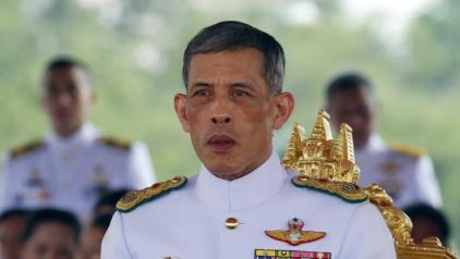 Thailand's Crown Prince Maha Vajiralongkorn watches the annual Royal Ploughing Ceremony in central Bangkok, Thailand, May 13, 2015. The ancient ploughing ceremony in Buddhist Thailand, overseen by Thailand's Crown Prince Maha Vajiralongkorn, marks the end of the dry season and is meant to herald an auspicious start for the rice-planting season.  REUTERS/Chaiwat Subprasom