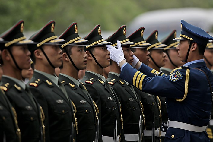 A Chinese officer, right, adjusts the line of the honor guards before the arrival of German President Horst Koehler, unseen, for a meeting with Chinese President Hu Jintao at the Great Hall of the People in Beijing, China, Monday, May 17, 2010. (AP Photo/Muhammed Muheisen)