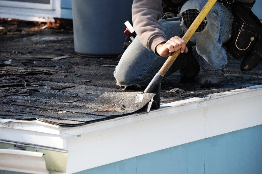 Calgary Roofing Companies | Claw Roofing | roofer doing a roof repair