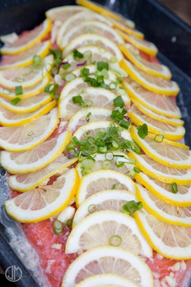 salmon cooking with lemon