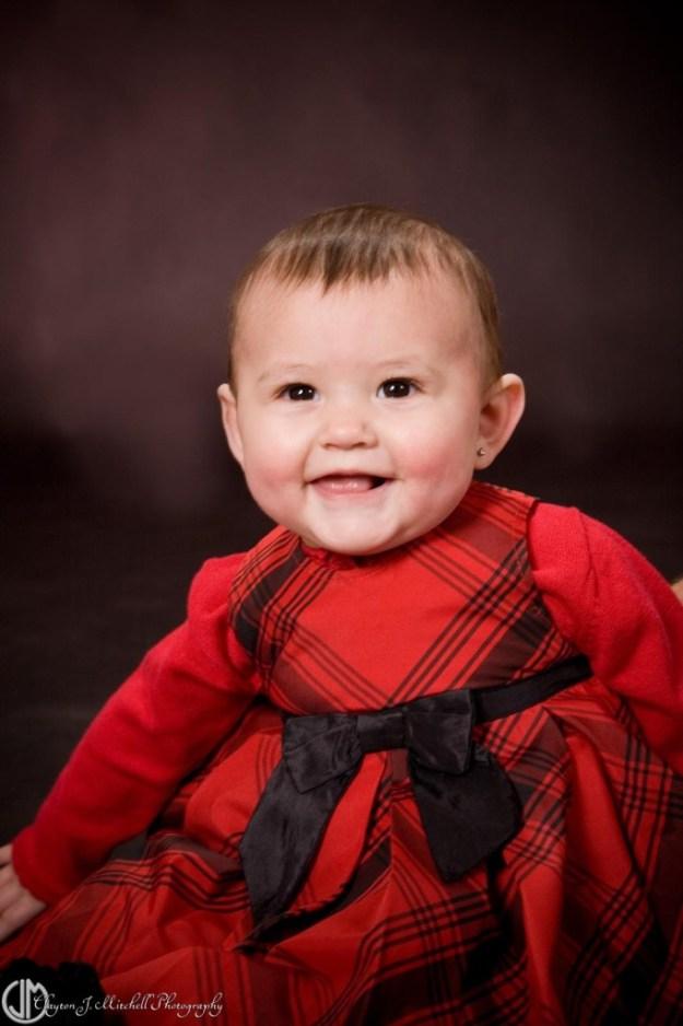 Smiling Baby Wearing Red Dress
