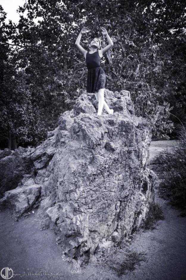 child dancer on rocks