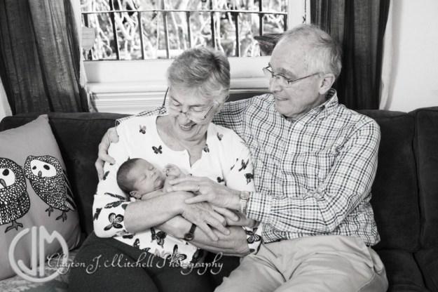 photo of grandparents and newborn