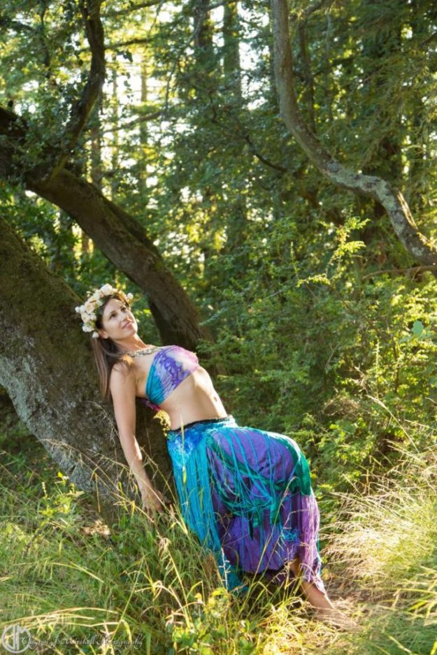 Modern Bohemian Forest Goddess Leaning Against Tree