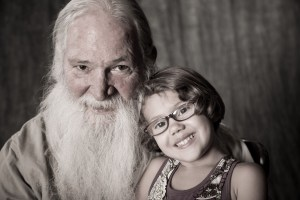 Desaturated Grandpa and granddaughter Studio photo