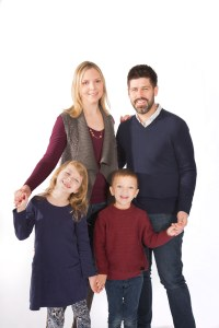 Family of four on white in studio