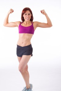 Fit woman shows muscles for Oxygen Magazine