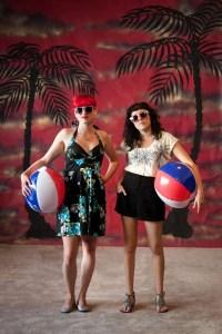 Girls on a fake beach band photo