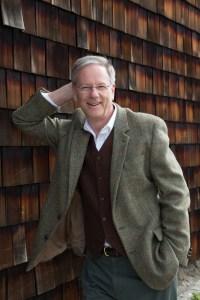 older gentleman in tweeds on a cedar shingle background