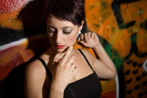 Edgy model poses on graffiti wall