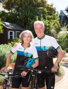 Older couple wearing cycling outfits