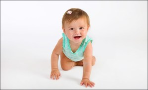 Happy baby posing on white background